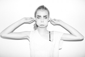 Black and white Cara Delevingne emotion shows a monkey