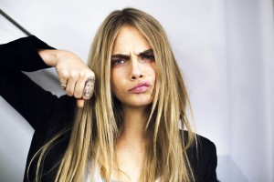 Picture Cara Delevingne tattoo on the index finger