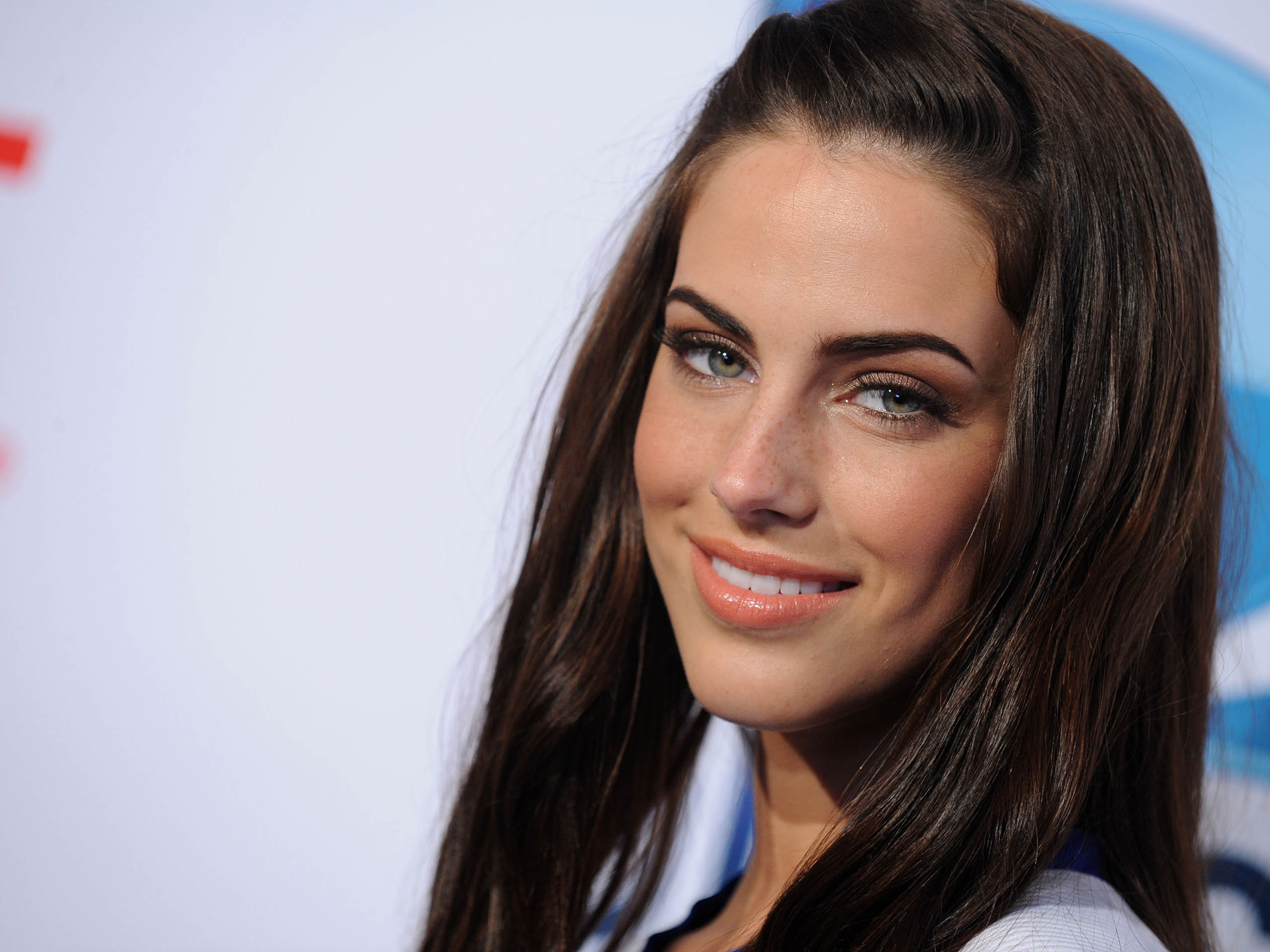 Brunette Jessica Lowndes on the blue background HD