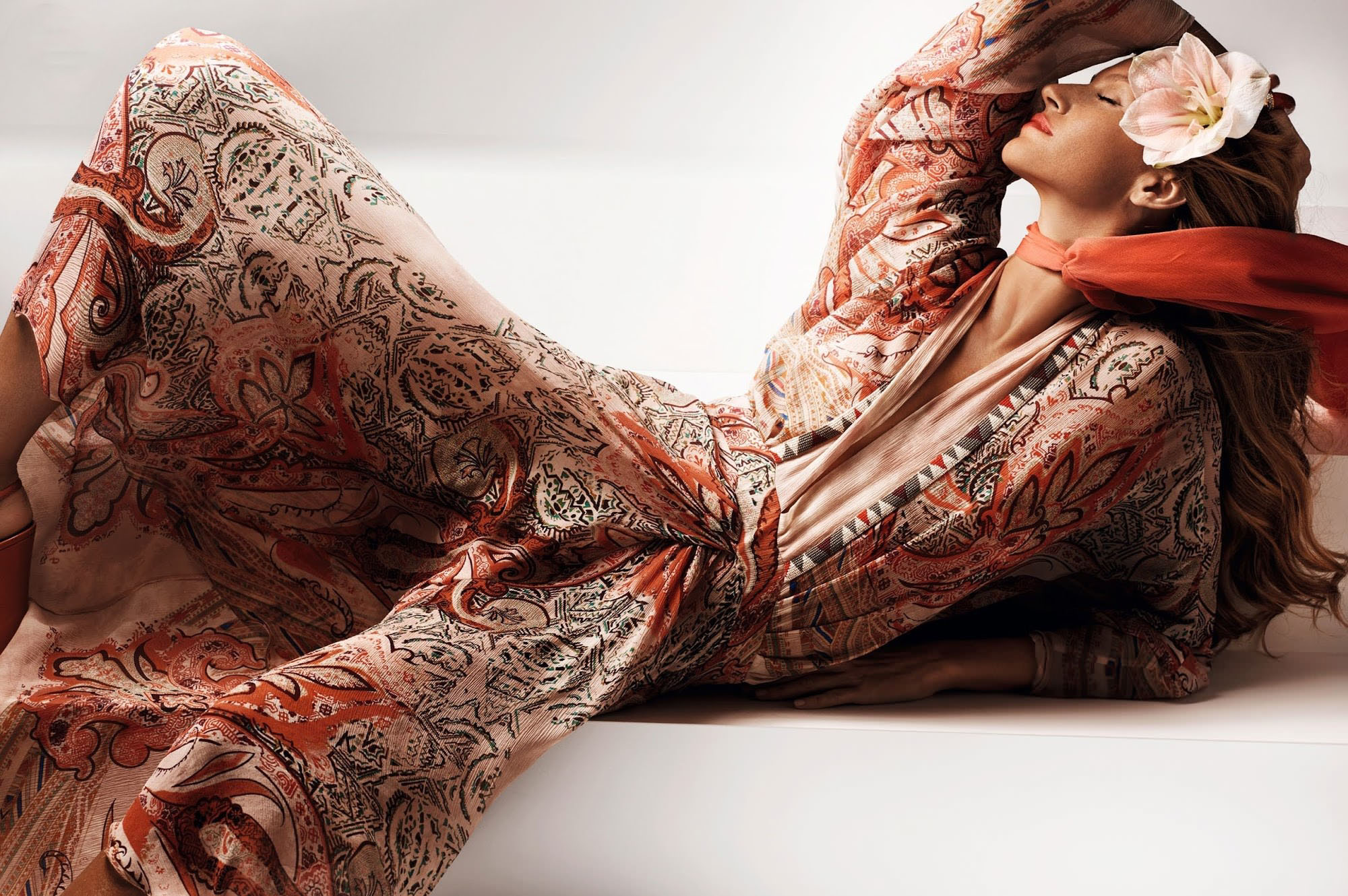 Gisele Bundchen is lying in dress for Vogue China March 2015