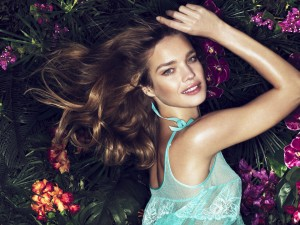 Smiling Natalia Vodianova wallpaper with curly hair