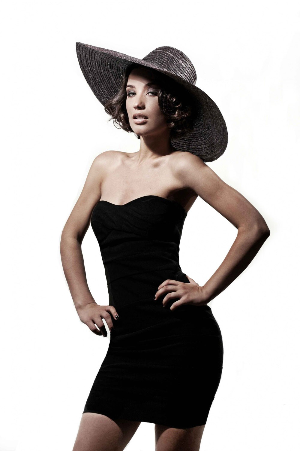 Photo Victoria Daineko in black dress with hat