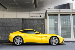 yellow ferrari f12 berlinetta side view