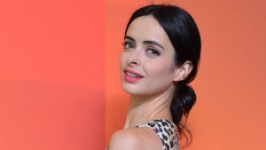 Krysten Ritter red background