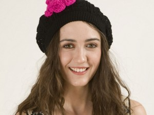Smiling Madeline Zima in hat