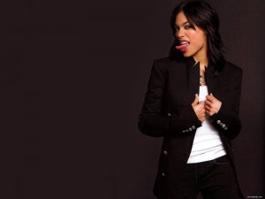 Rosario Dawson black background