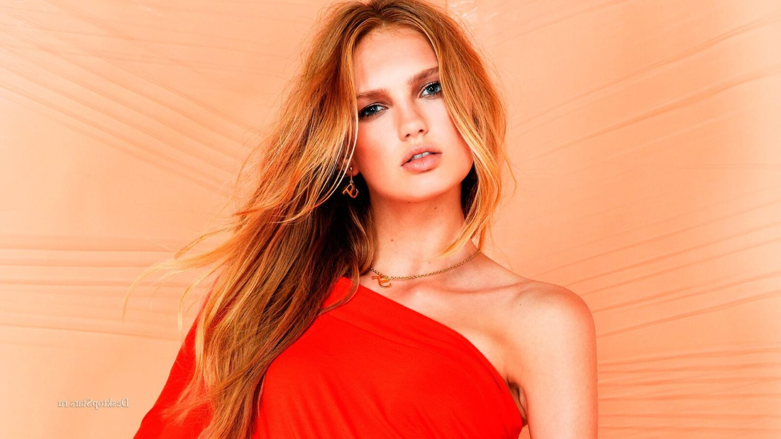 Romee Strijd in red dress background