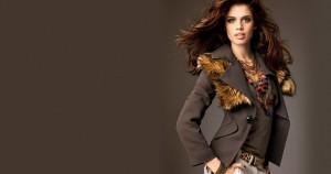 Sara Sampaio in brown jacket background