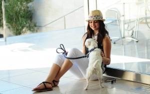 Beautiful Selena Gomez with dog wallpaper