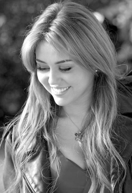 Smile of Miley Cyrus long hair bw picture