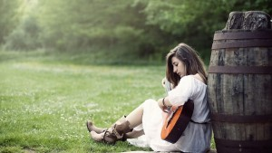 Girl with guitar in the field full HD image
