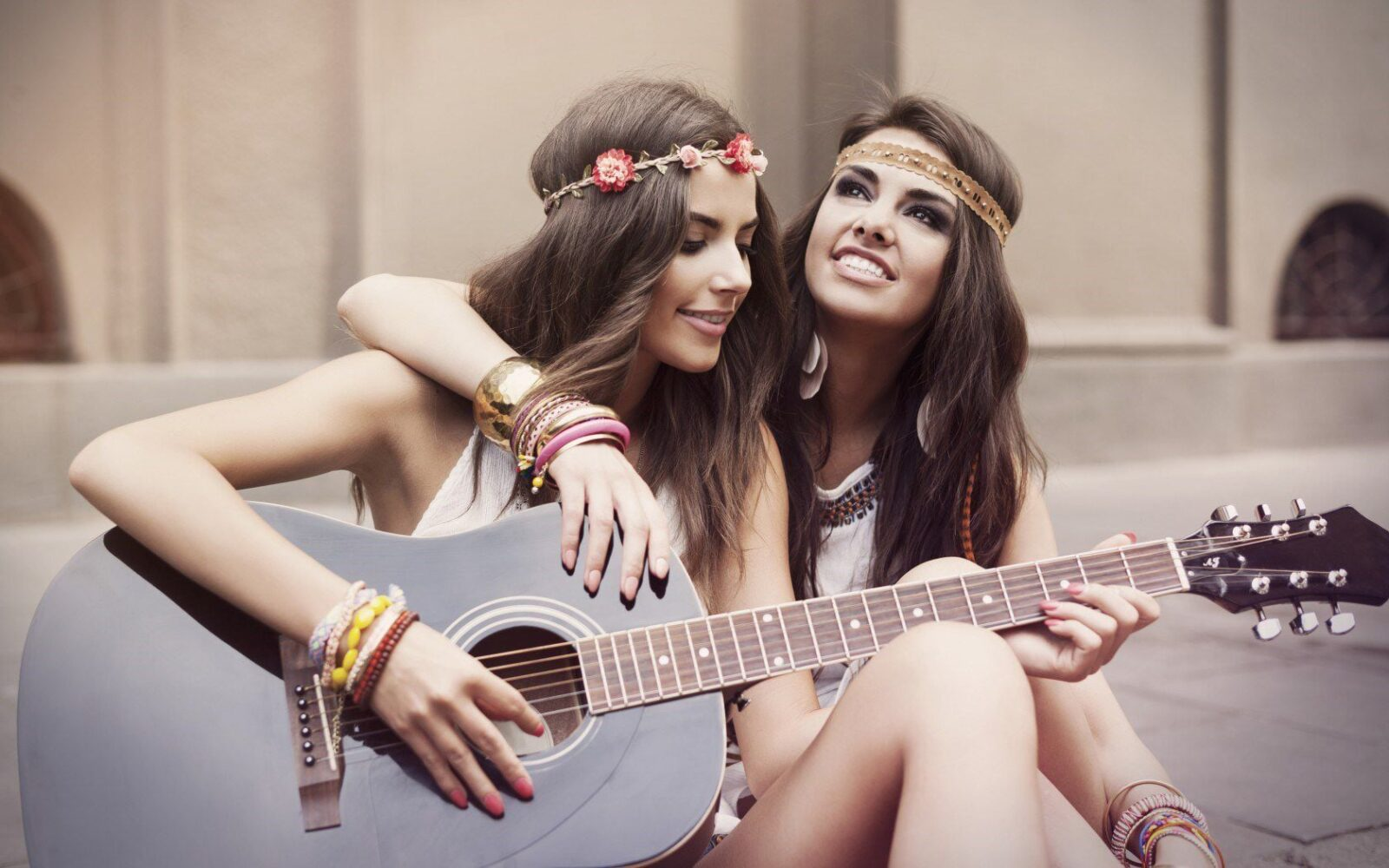 photo of two beauty girls with guitar