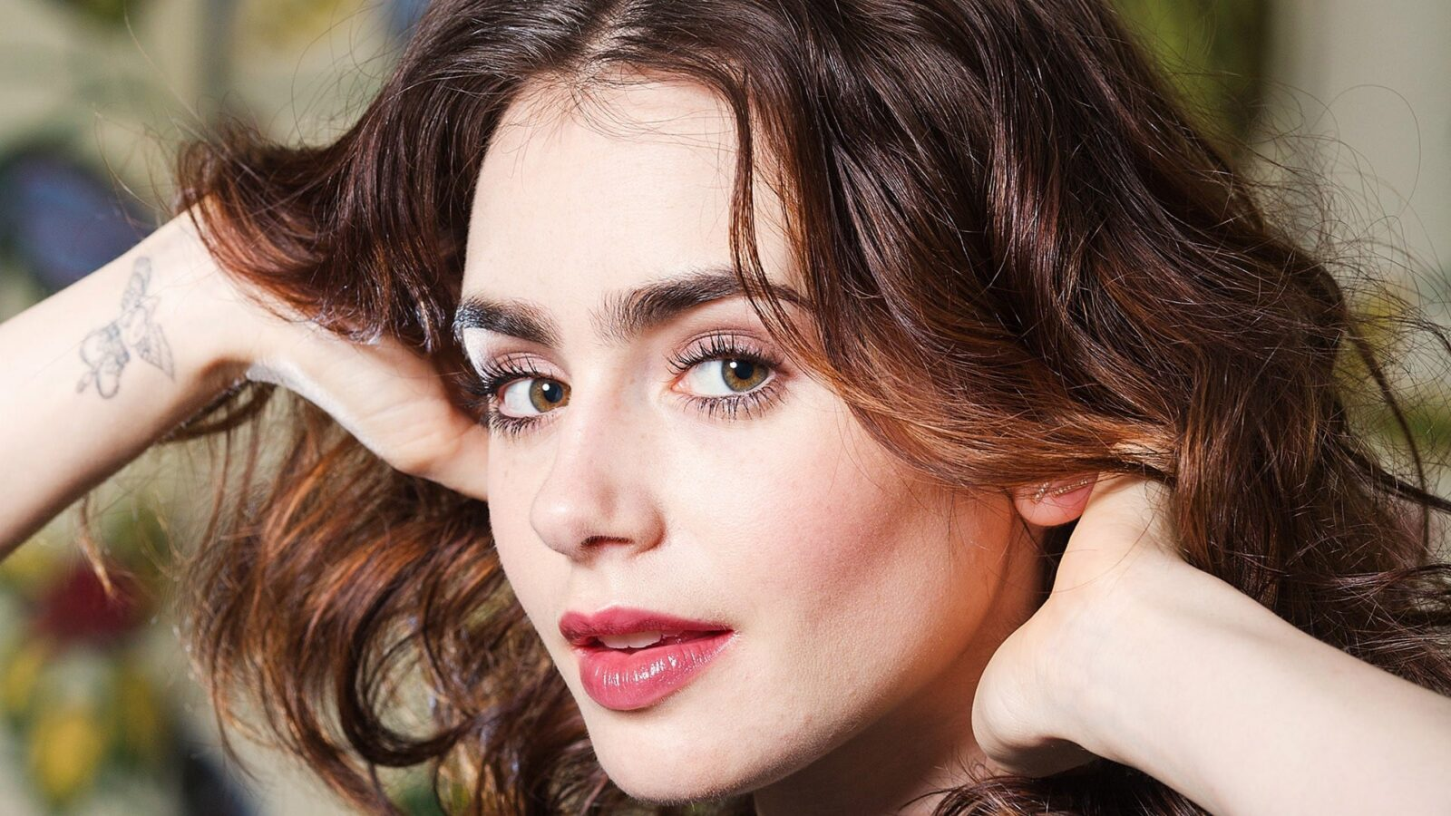 Lily Collins tattoo hand 2016