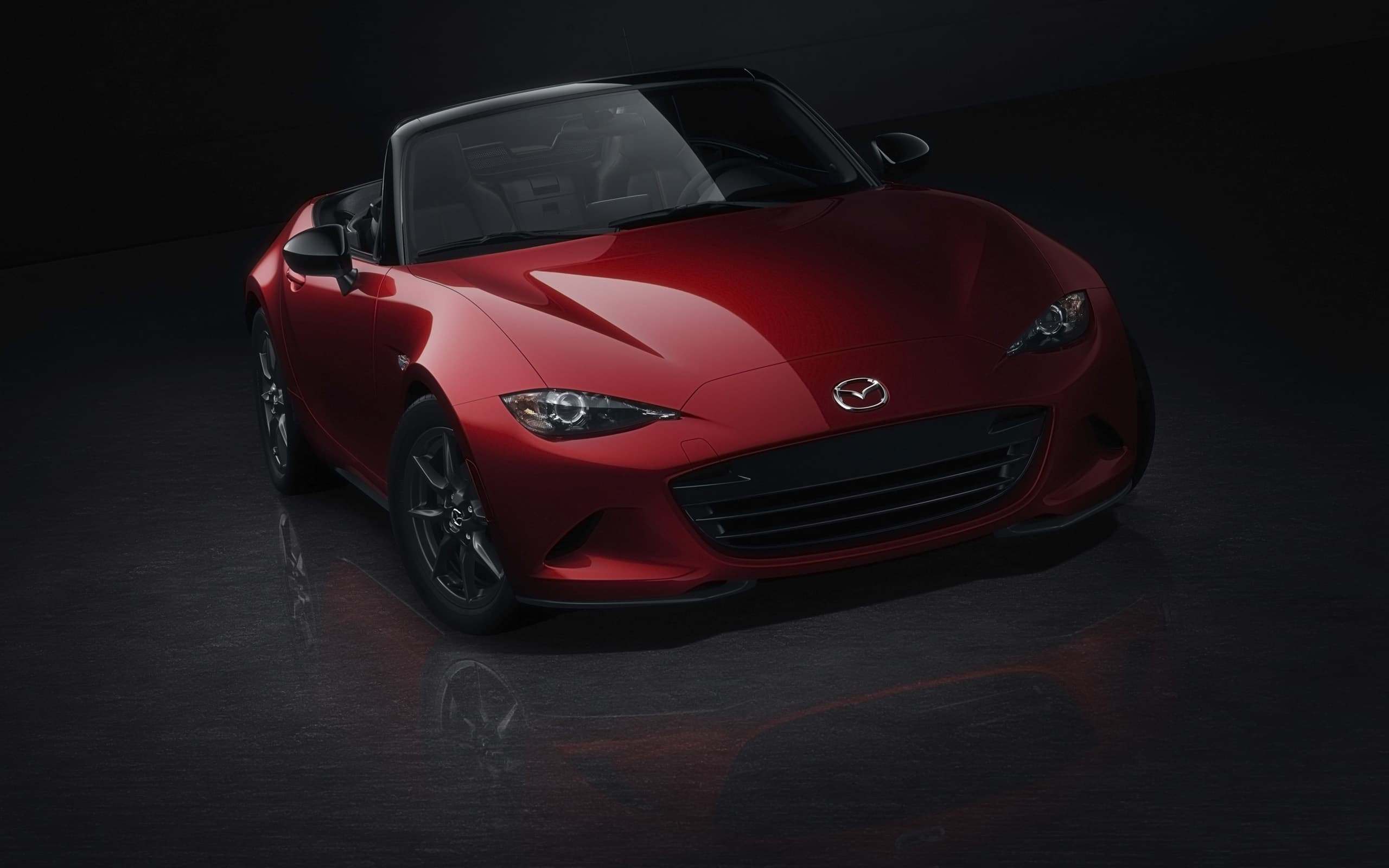 red 2016 Mazda MX-5 Miata black background image