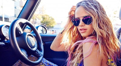 Halston Sage in a car