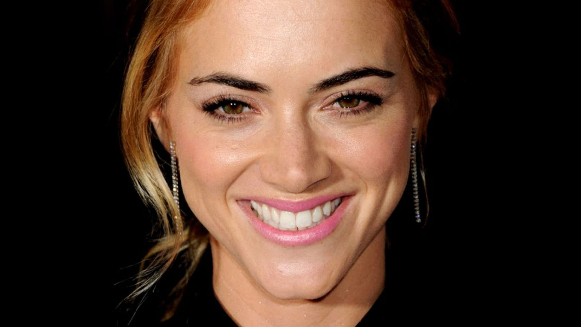 Emily Wickersham background smile