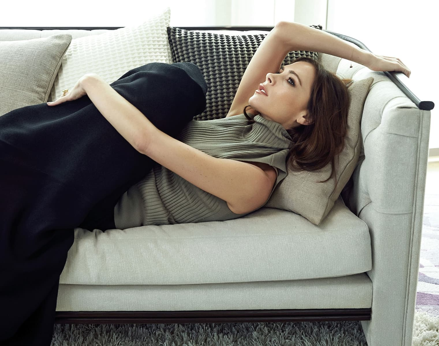 HD wallpaper of Victoria Beckham on the couch