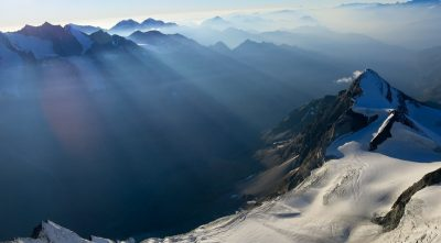 Switzerland, - mountain Weisshorn, sun rays