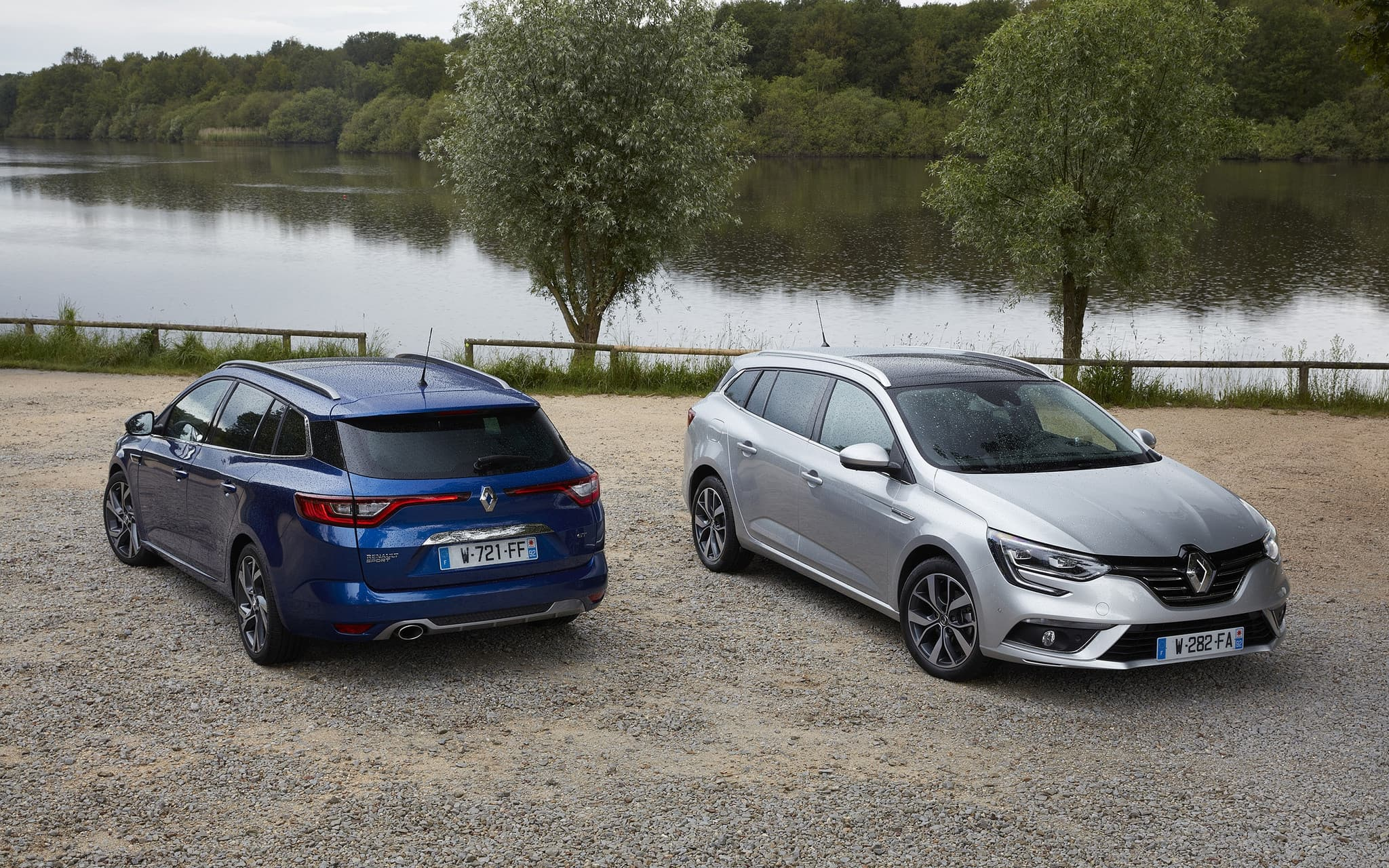 two cars - 2016 Renault Megane Sport Tourer silver and blue