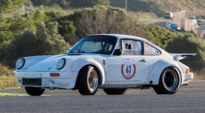 white sport car Porsche 911 3.0 RS