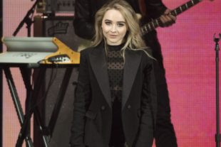 Sabrina Carpenter in black jacket
