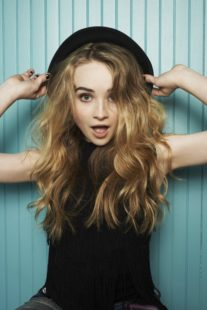 Sabrina Carpenter in black hat