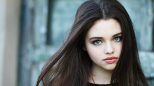 India Eisley as Ashley Juergens