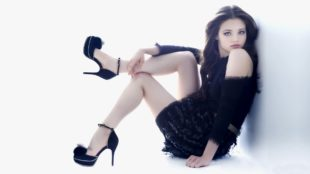 India Eisley as Martha