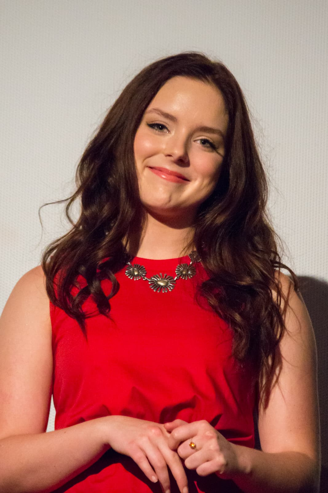 Madison Davenport in red dress