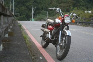 red Suzuki T200 standing on oad