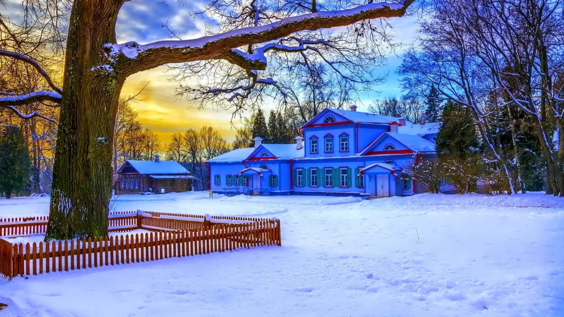 a large house at sunset in winter