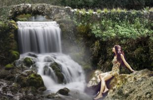 beautifull girl on a waterfall background