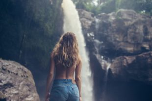 blonde girl on a waterfall background