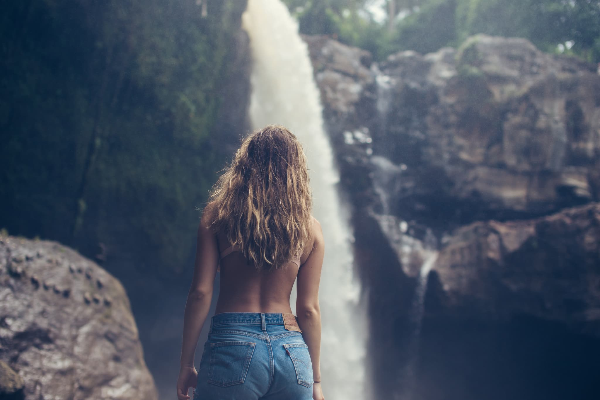 Girls on a waterfall background