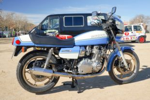 blue Suzuki GS1000S on sand