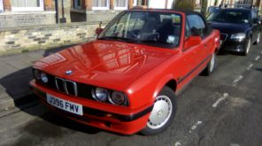 red BMW m3 e30 convertible