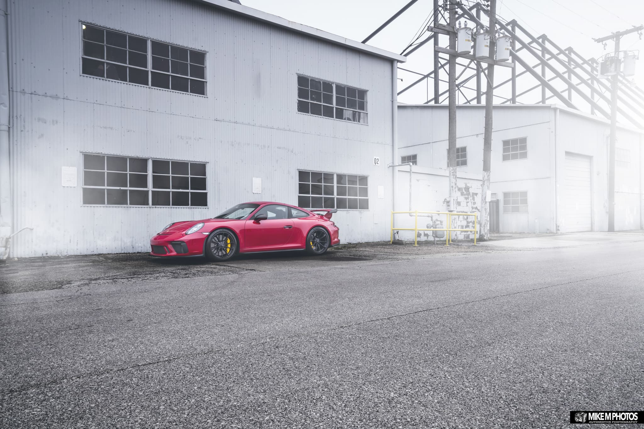 red Porsche GT3 911 on road
