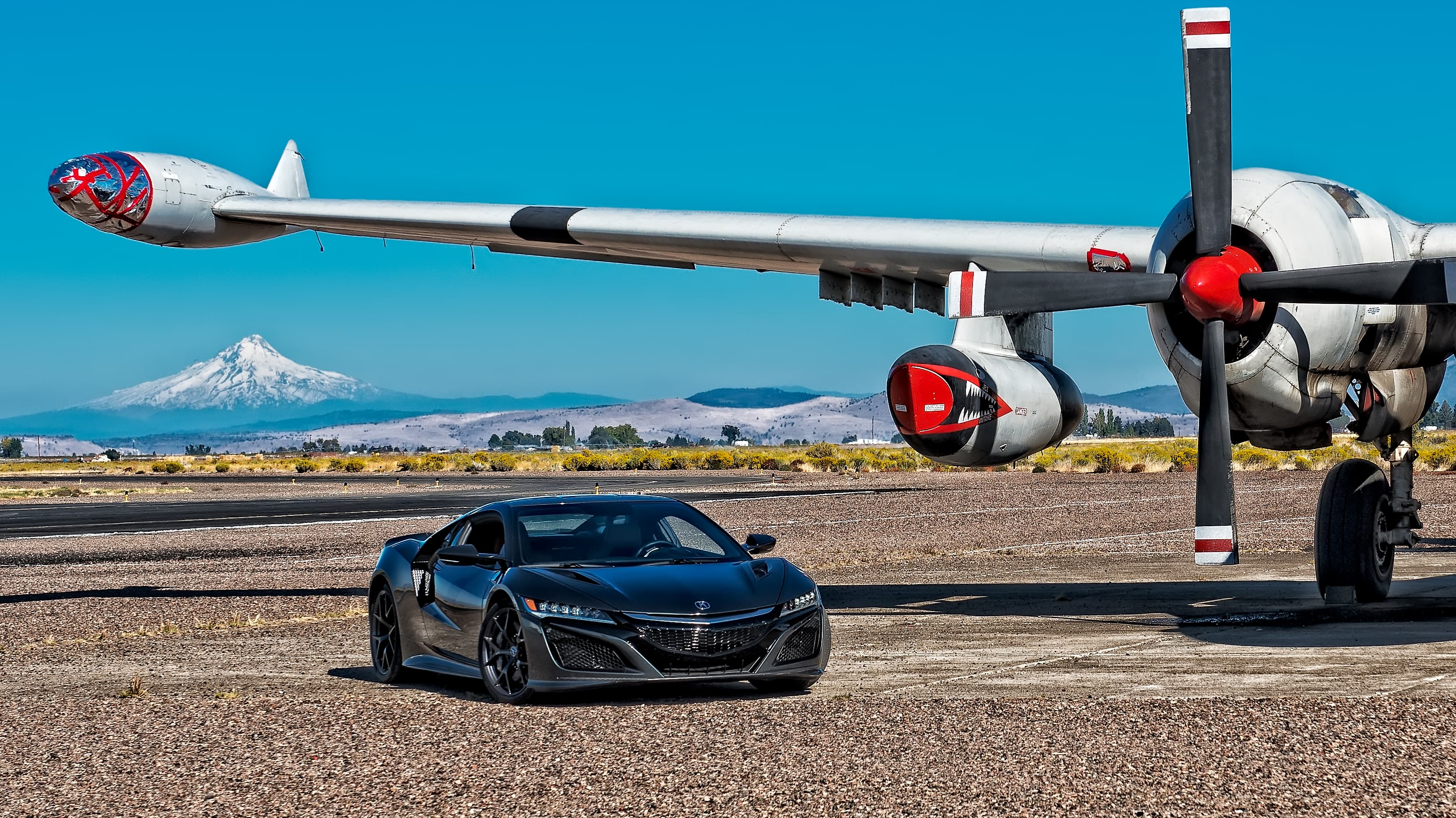 2017 black Acura NSX under a wing of a airсraft