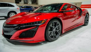 2017 red Acura NSX - side view