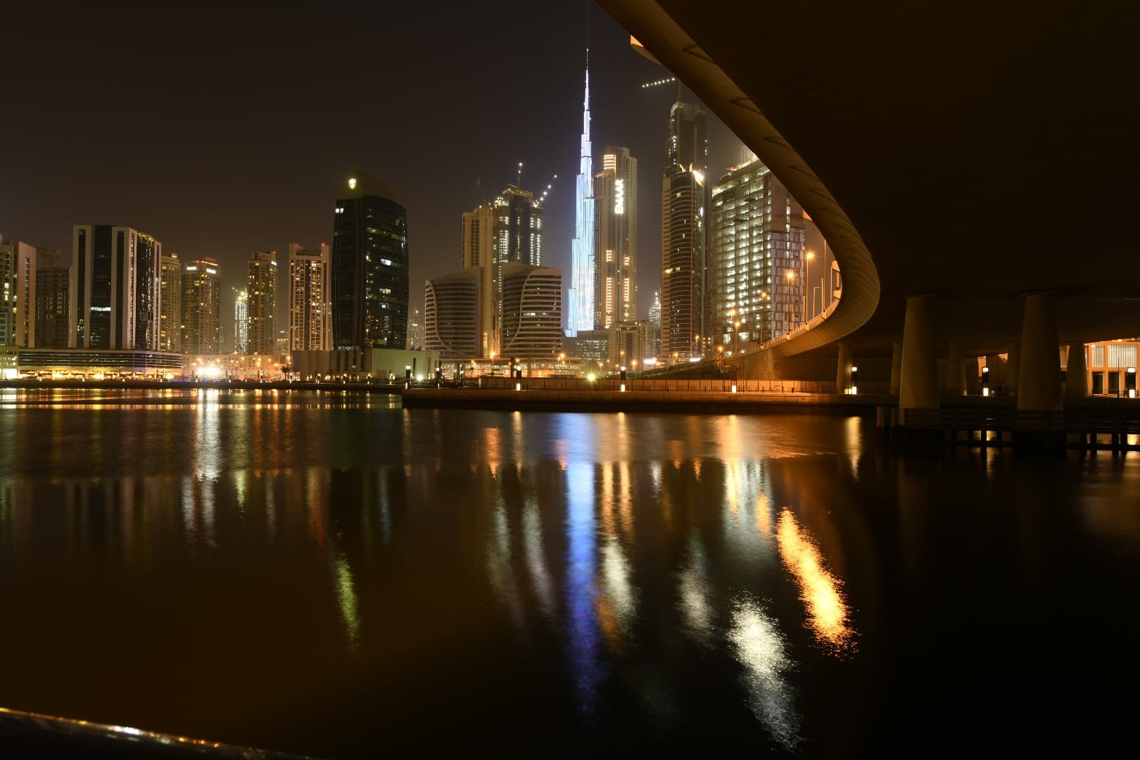 view of Dubai from under a bridge