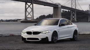 white BMW M4 coupe