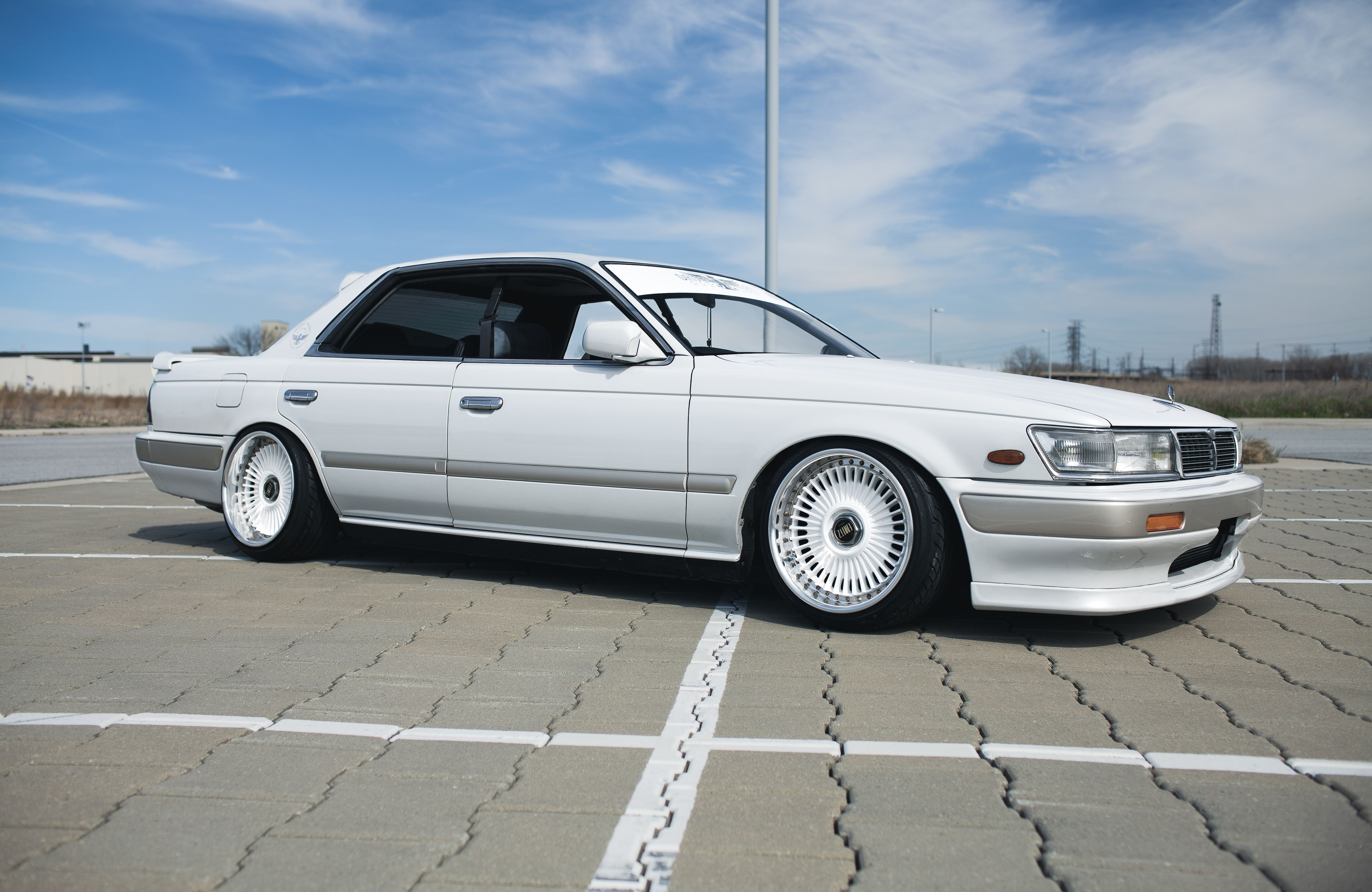 white Nissan Laurel