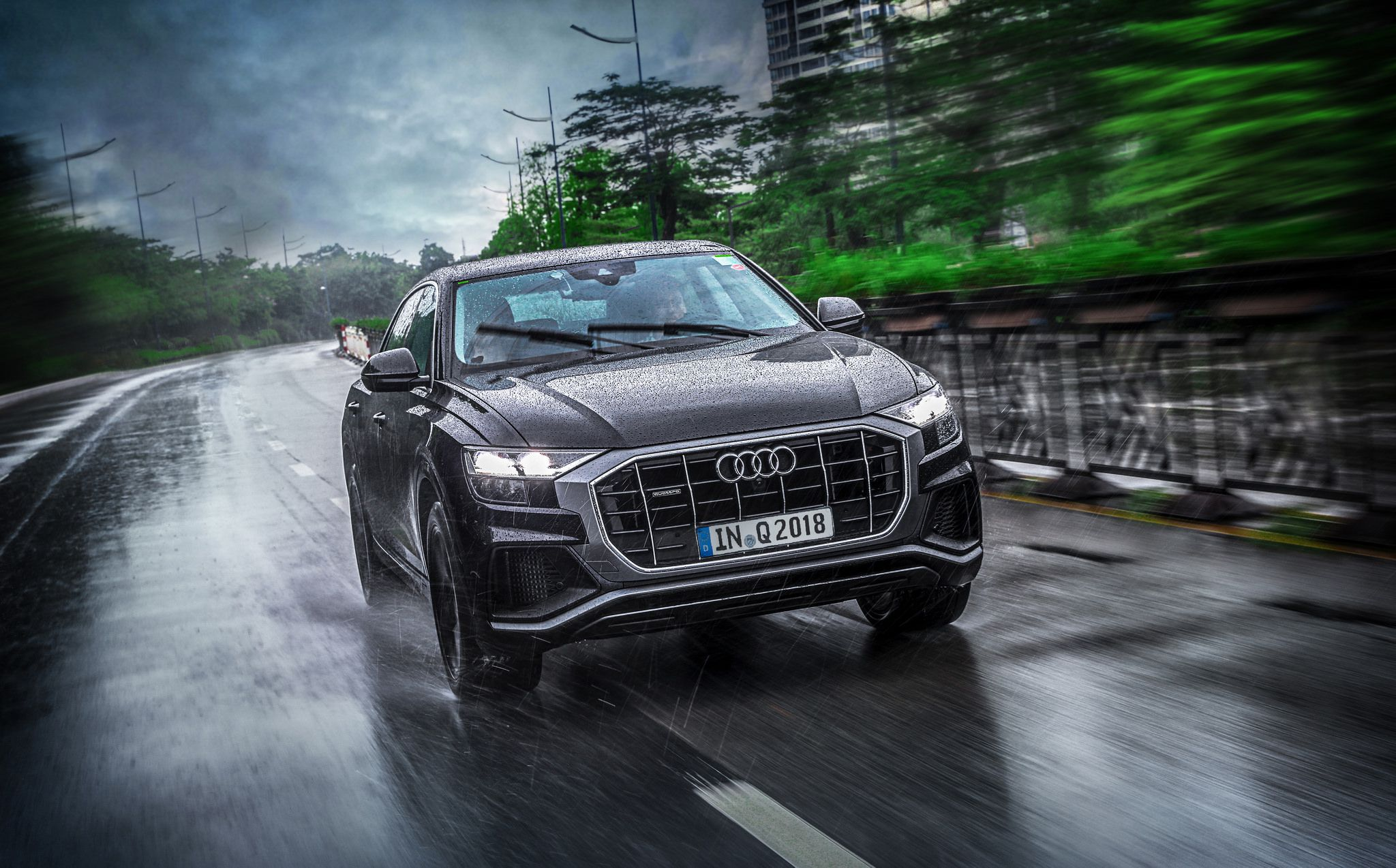 2019 black Audi Q8 at speed