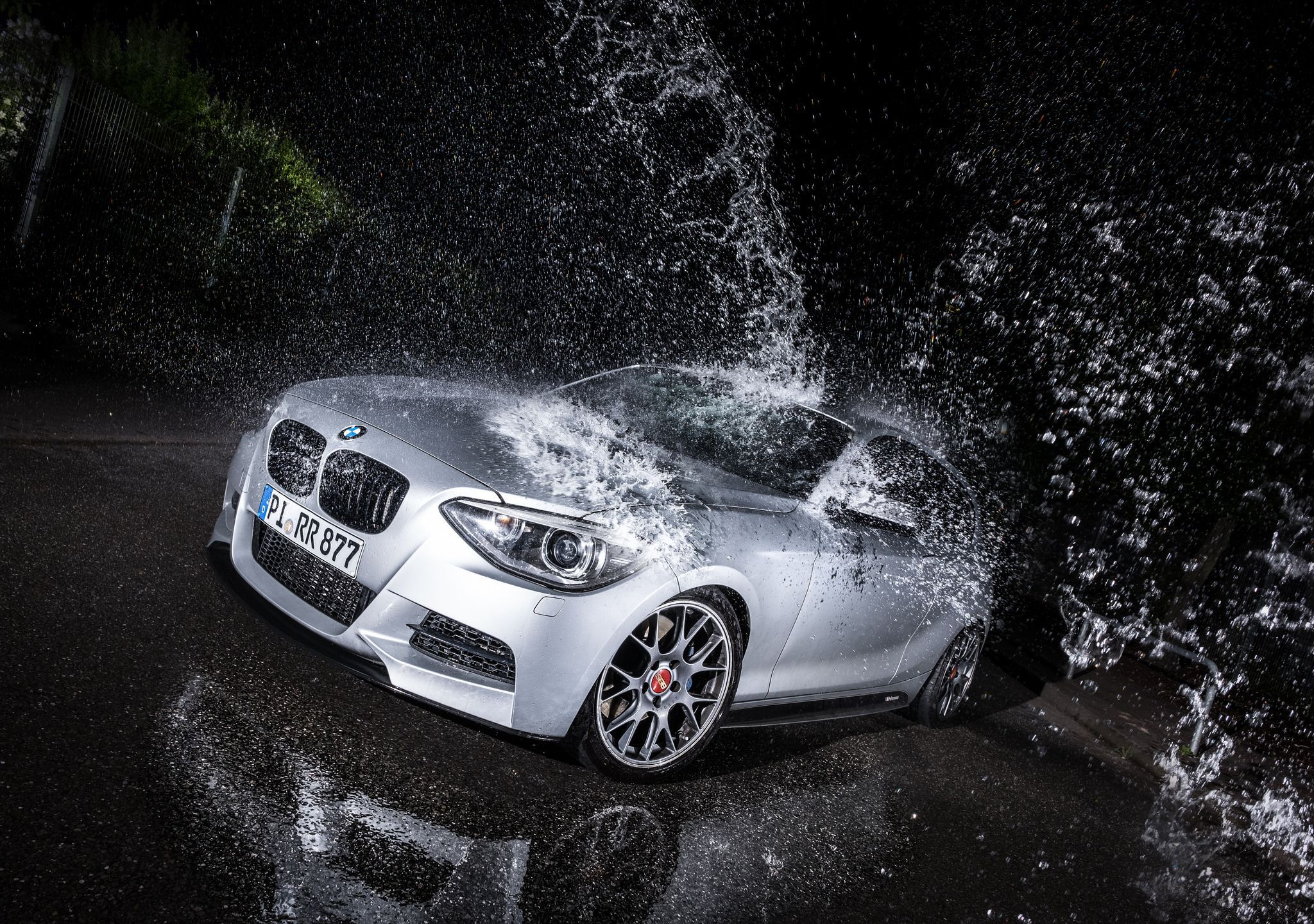 Silver BMW M135i under the drops of water
