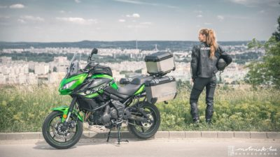 green Kawasaki Versys 650 SE with a girl