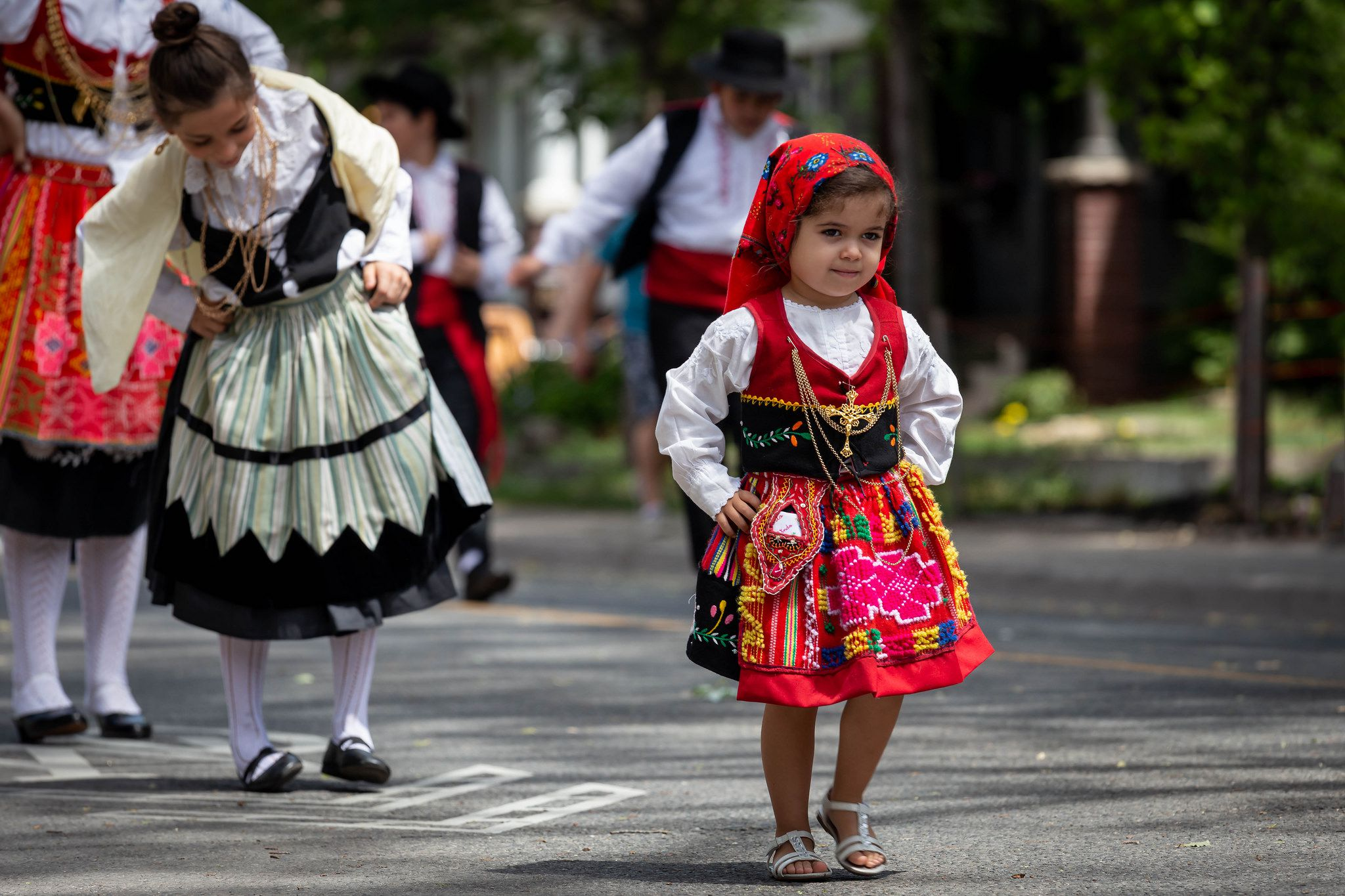 a little beautiful girl in national dress for day Portugal Day
