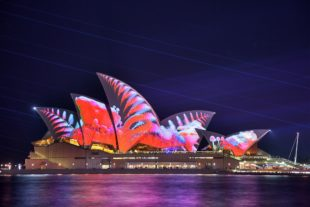 red jungle of Sydney Opera House at night
