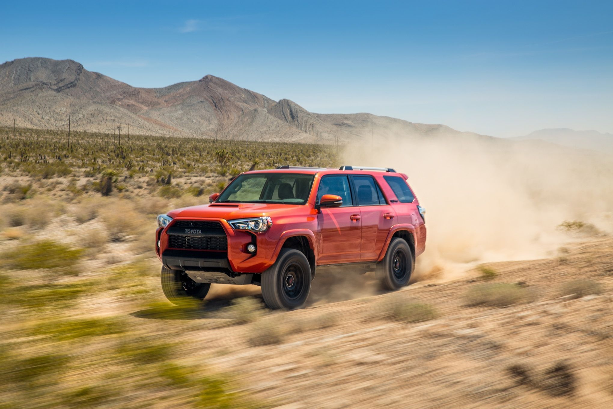 2018 red Toyota 4Runner at speed after a desert