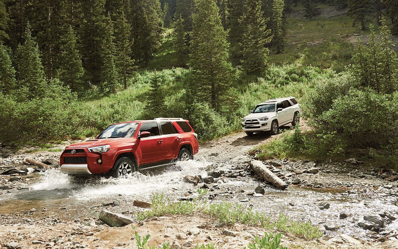 2018 red Toyota 4Runner after a creek