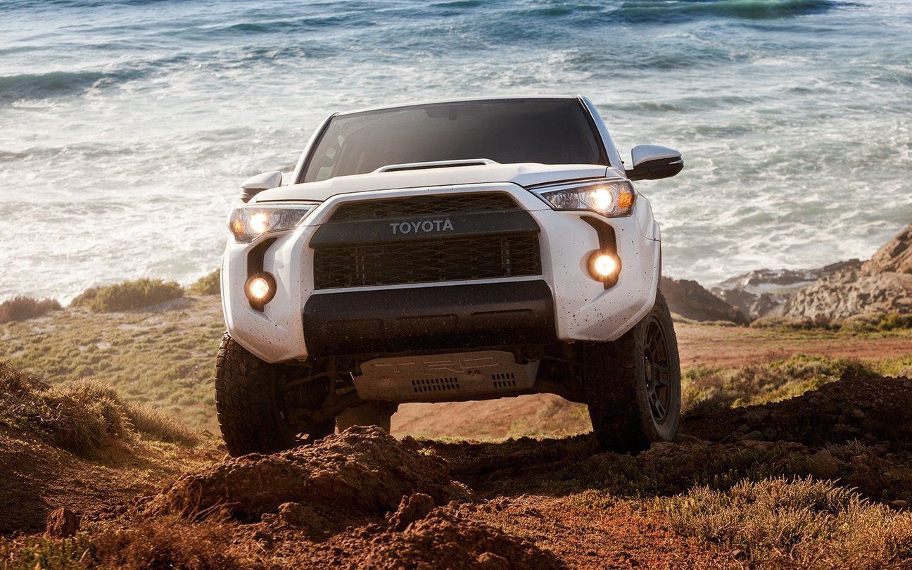 2018 white Toyota 4Runner at a sea background